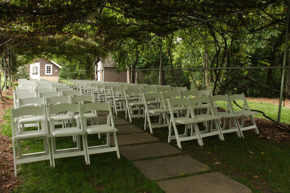 wedding-ceremony-chairs-under-grape-arbor