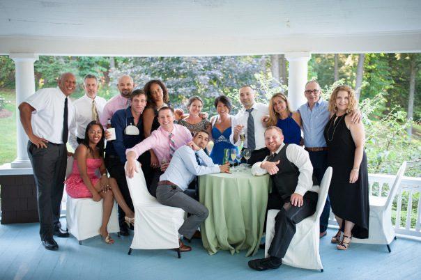 wedding guests surrounding table on veranda
