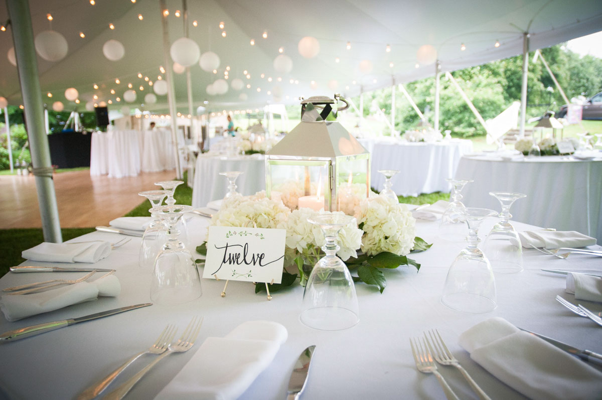 high-school-sweethearts-wed-at-tent-wedding-table-set-with-flowers