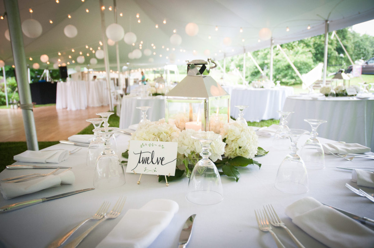 table set up with lantern and flower arrangement