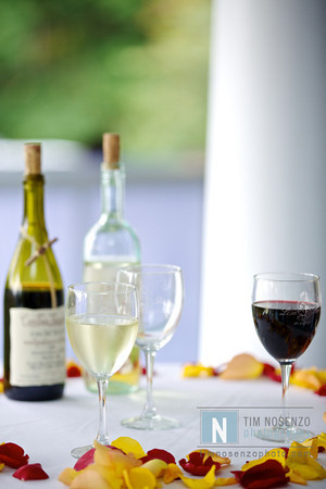 wine glasses with bottle on a table out on the veranda