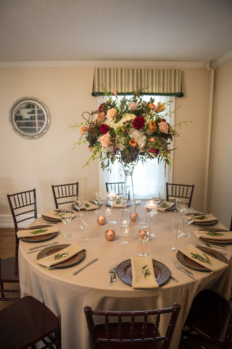 Light brown linen accented with chocolate charger plates