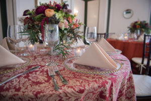 Bold paisley combined with off white napkins tie everything together in this non-traditional table setting.