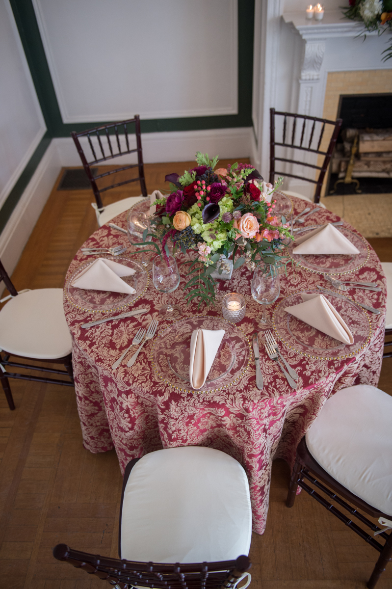 paisley linnens with clear plates and white linens