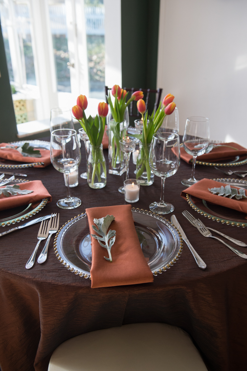 Beautiful spring table settings in varying shades of brown with gold edged plates