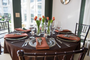 Shades of brown with spring tulips table setting