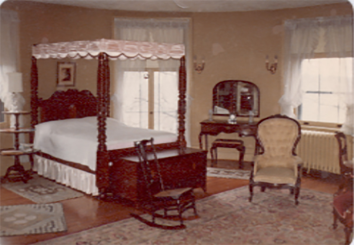 castle-bedroom-with-canopy-bed-french-doors