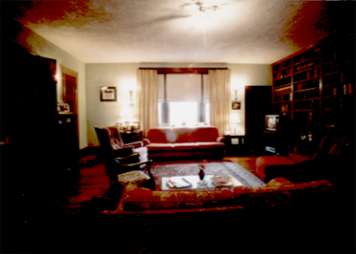 heathstone-castle-living-room-in-reds-and-dark-wood