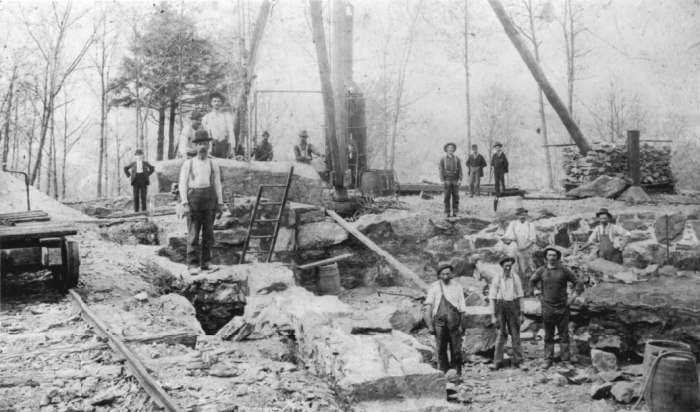 """black and white photo of """"Mad Hatters"""" working to mine limestone for the Hearthstone castle"""