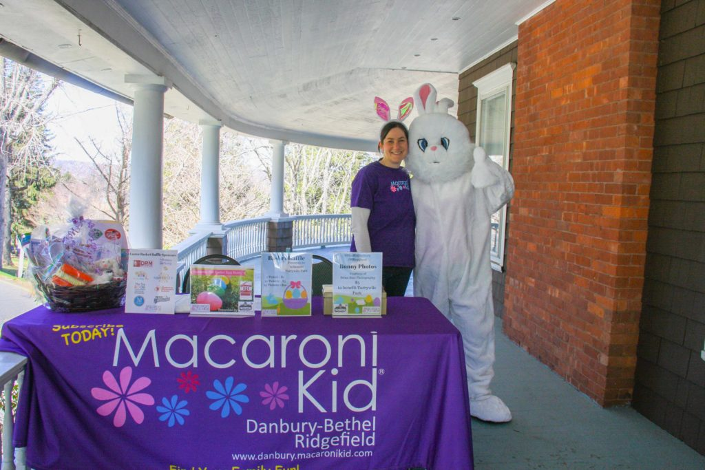 meghan frieland and the Easter bunny post for a photo on the veranda