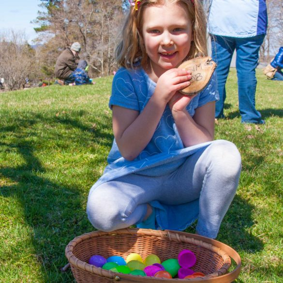 Natalie showing off her finds after the Easter Egg Hunt Fundraiser