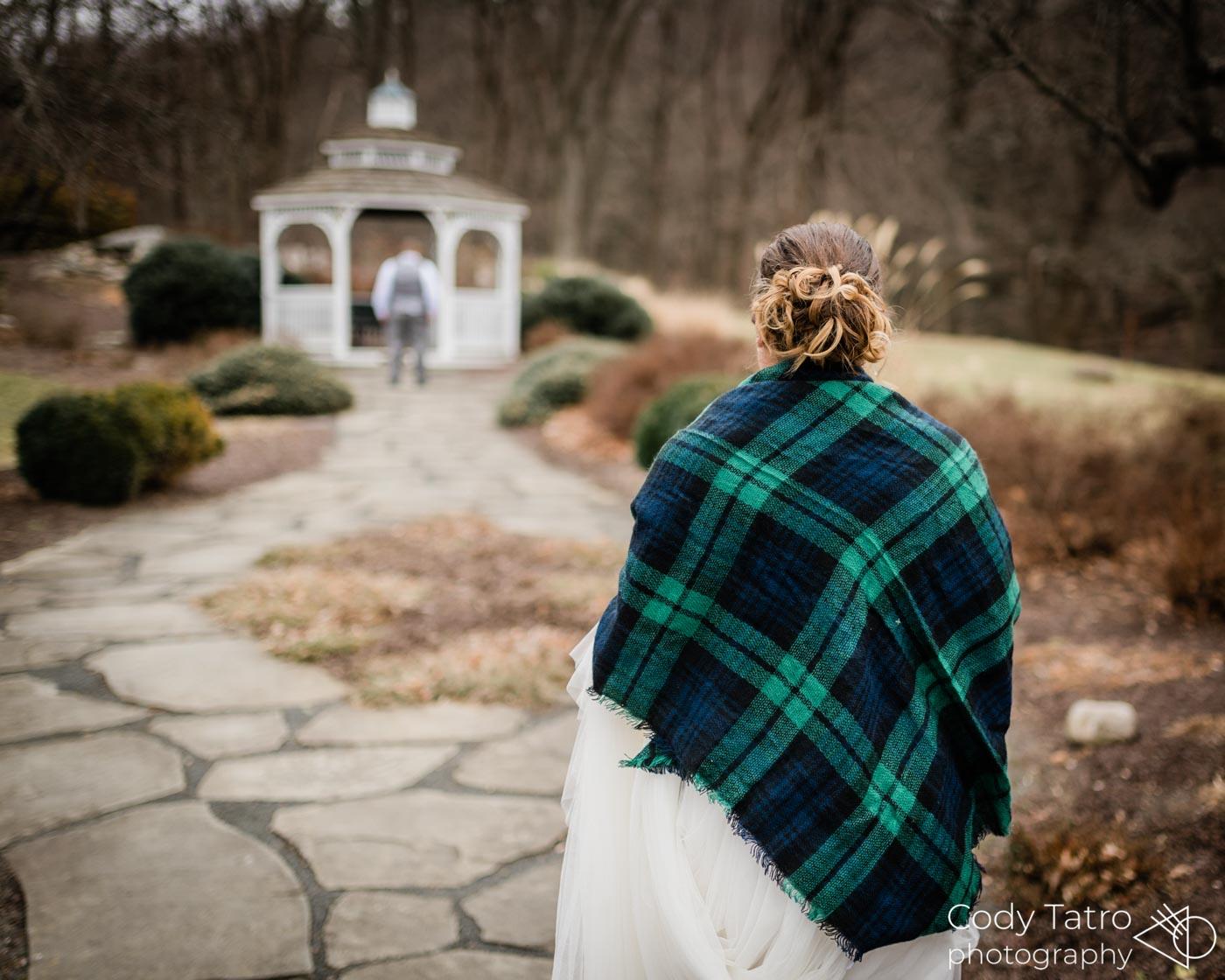 winter-wedding-bride-groom-first-look-by-gazebo