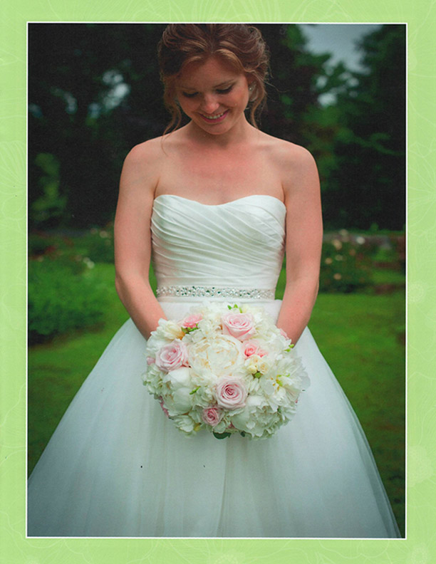 brochure-page-three-bride-looking-down-at-bouquet