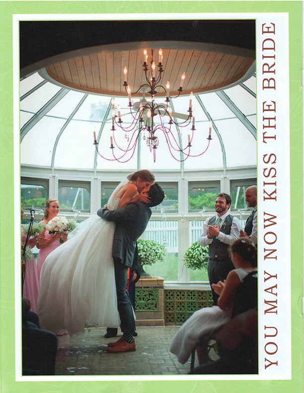brochure-page-six-groom-picking-bride-up-for-kiss-in-conservatory