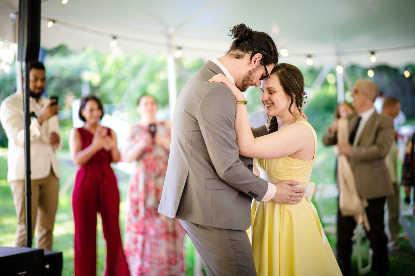 newlyweds-first-dance-under-tent