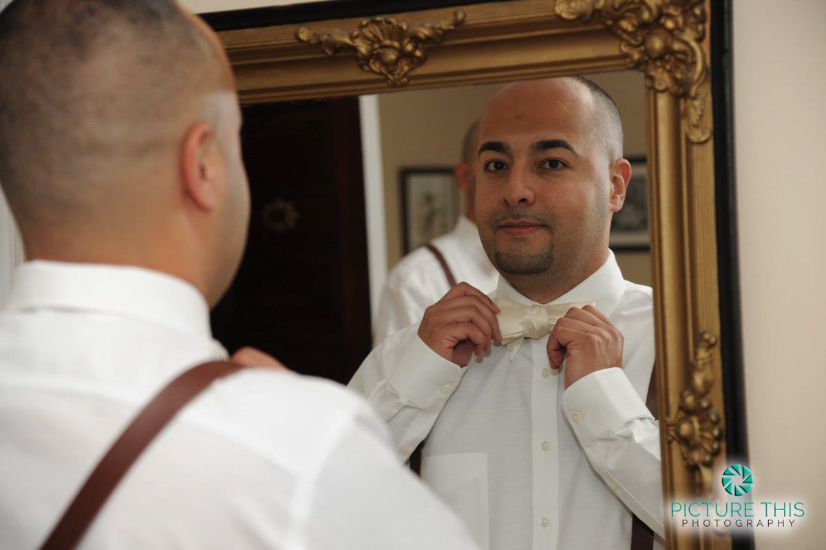 a-victorian-era-wedding-groom-putting-on-bowtie