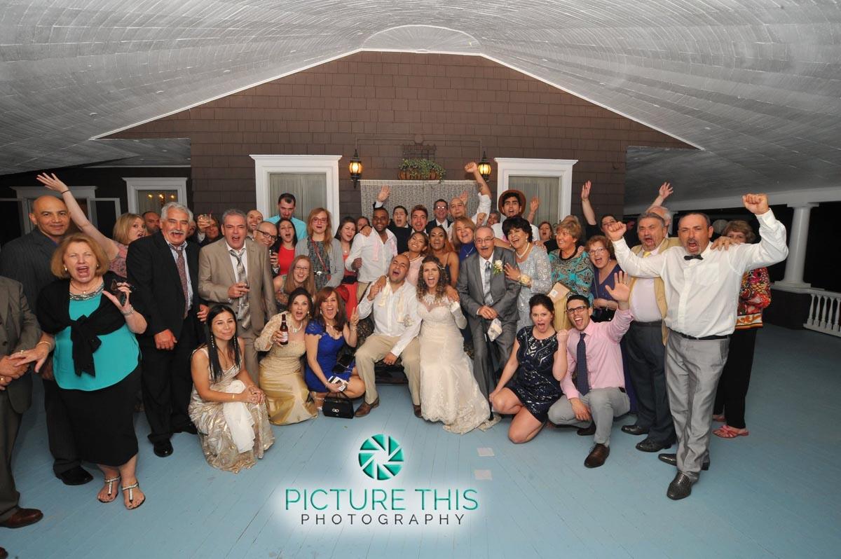 a-victorian-era-wedding-reception-group-photo-on-veranda