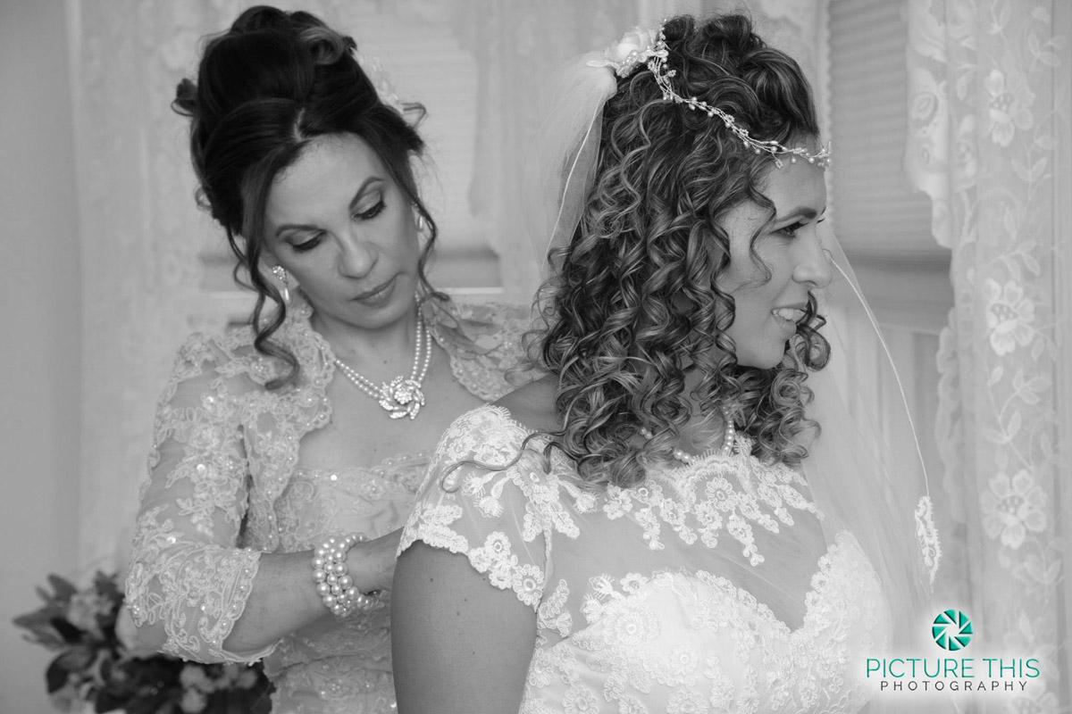a-victorian-era-wedding-with-m0m-helping-bride-to-get-dressed