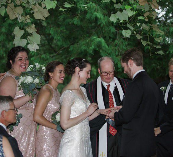 art-deco-wedding-couple-exchanging-rings-under-grape-arbor-ceremony