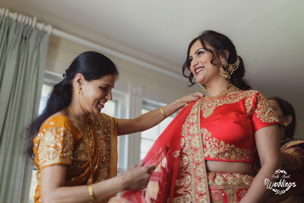 mom-helping-bride-with-brightly-colored-indian-reception-attire-danbury-ct