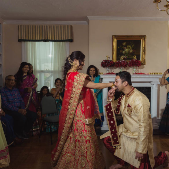 indian-groom-kneeling-before-indian-bride kissing-her-hand