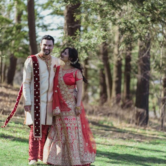 indian-wedding-couple-walking-on-grounds-smiling-at-camera-at-danbury-wedding
