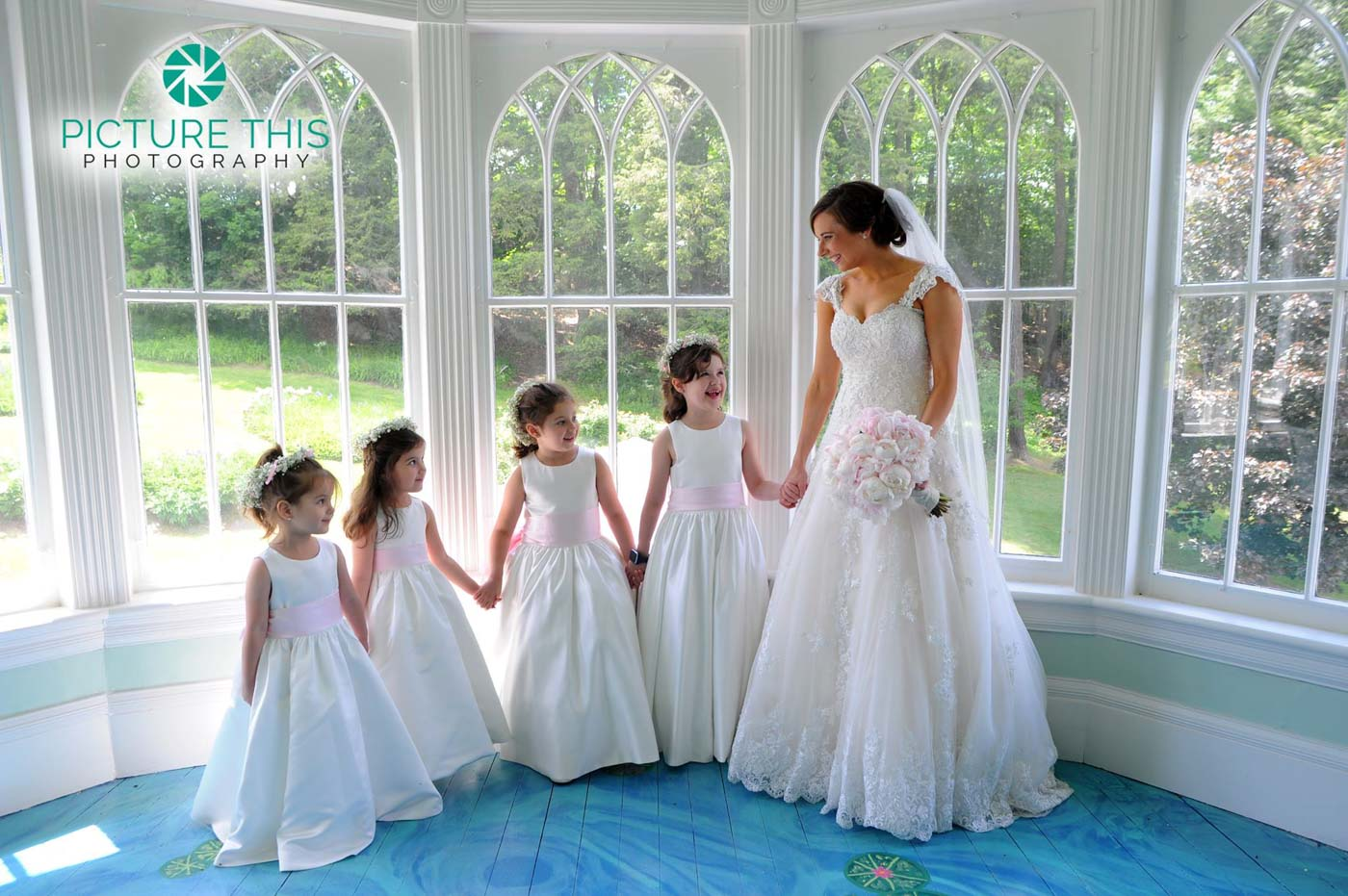 immaculate-bride-with-four-little-girls-on-lilly-pond-porch