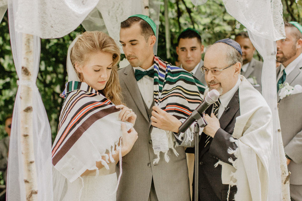 jewish-wedding-ceremony-shawl-draped-over-couple during-ceremony