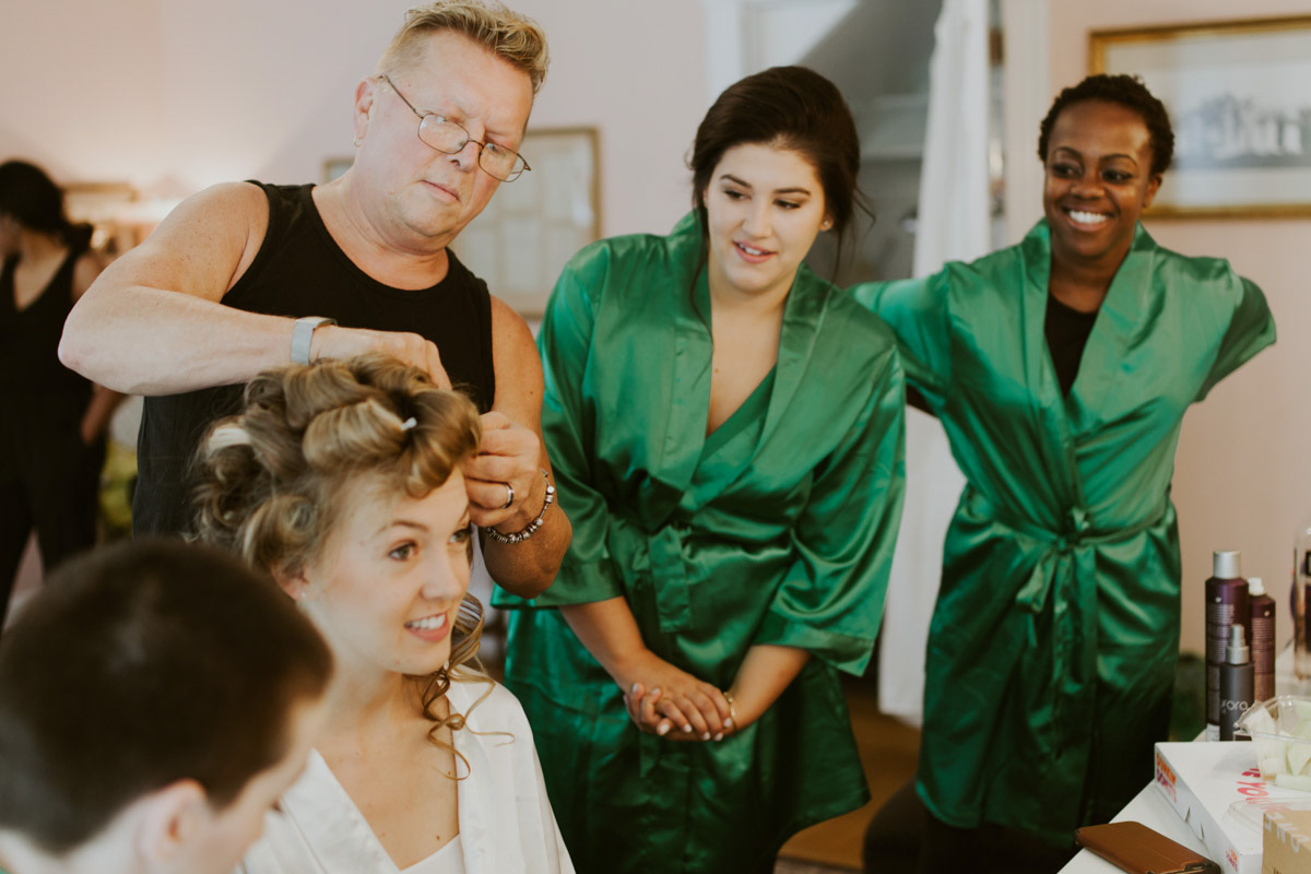 jewish-wedding-bride-getting-hair-done-while-bridesmaids-watch