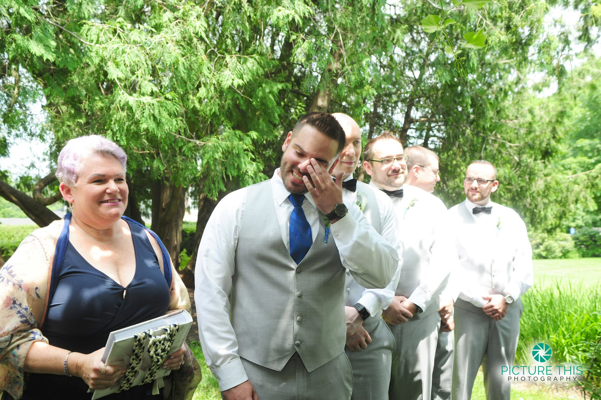 late-june-wedding-ceremony-groom-tears-up-at-sight-of-bride