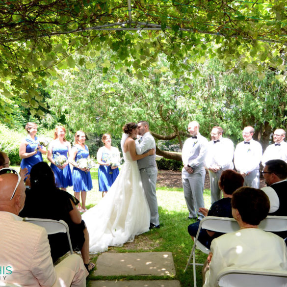 late-june-wedding-ceremony-ends-with-newlyweds-kissing