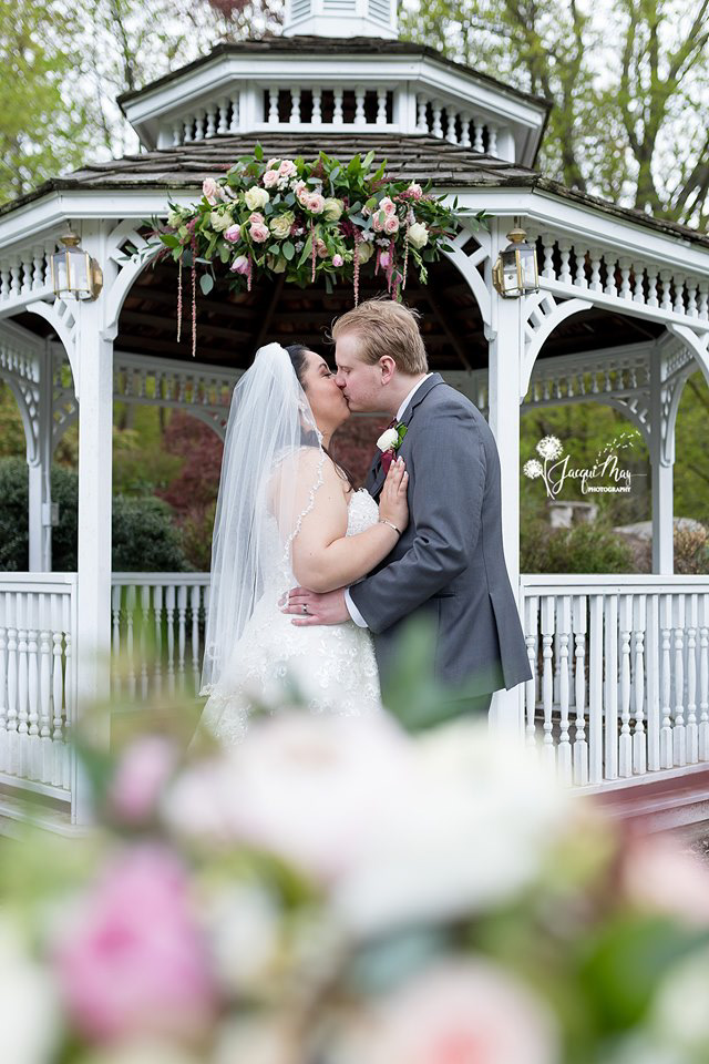 may-wedding-couple-kissing-in-front-of-gazebo