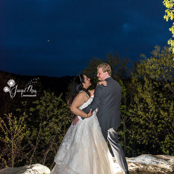 wedding couple embracing on overlook