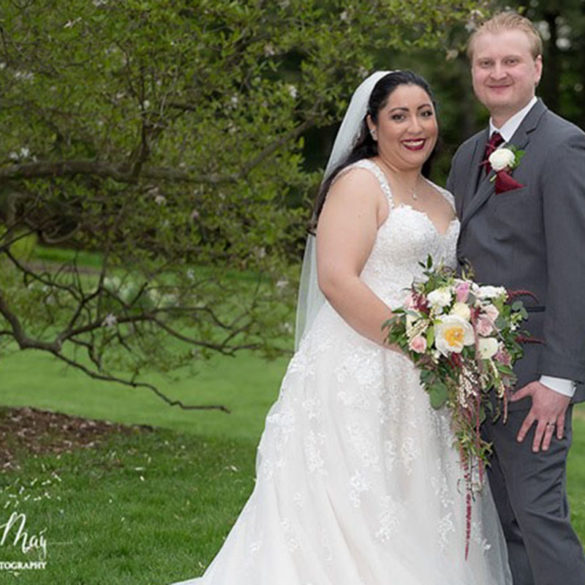 may-wedding-couple-standing-together-on-lawn
