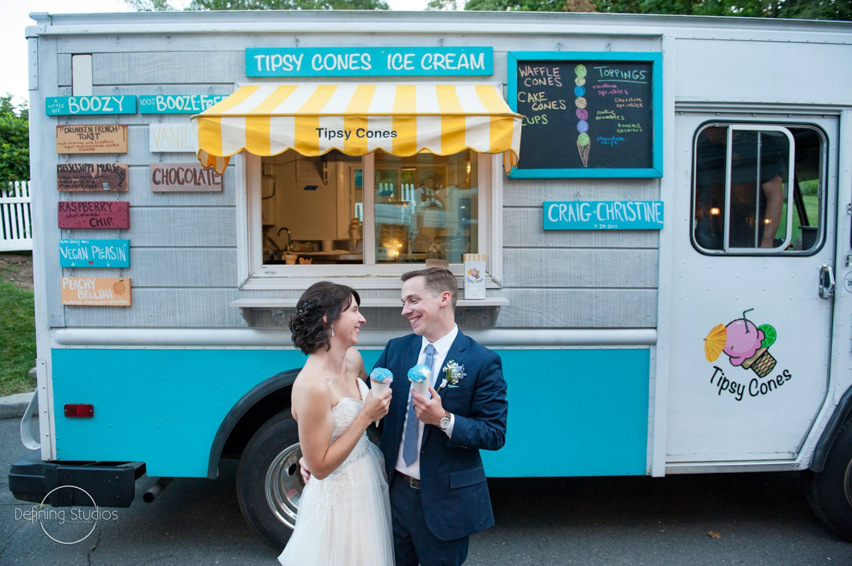 couple-in-front-of-dessert-truck-with-tipsy-cones-july-reception