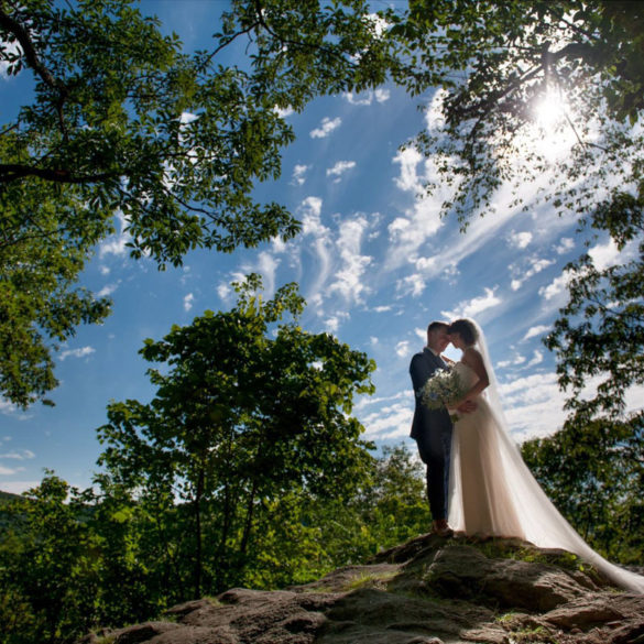 dream-wedding-couple-captured-in-silouette-on-rocky-overlook
