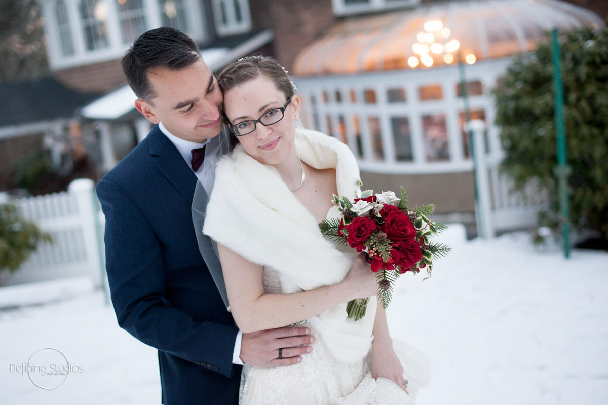 amanda and andy outside in front of conservatory with snow