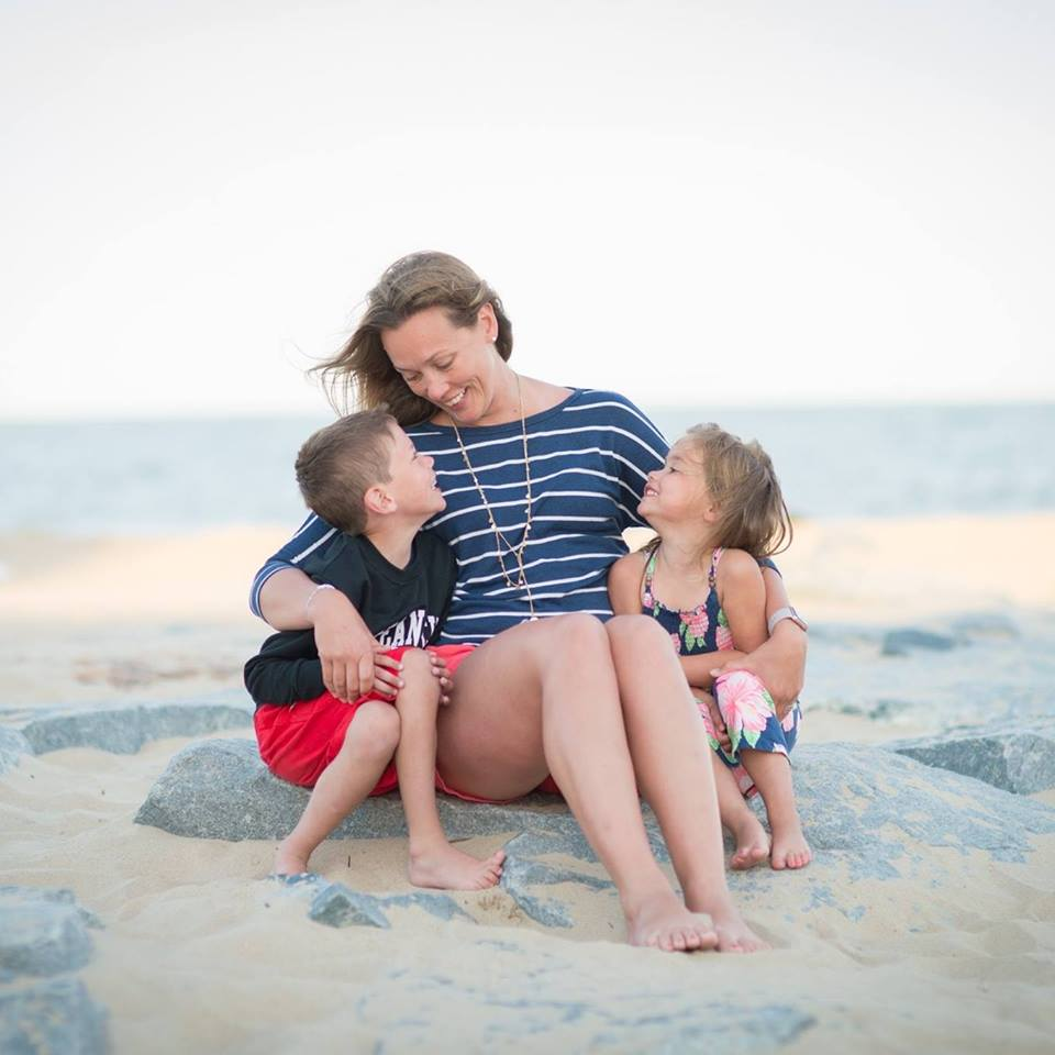 erica with her kids sitting on the beach
