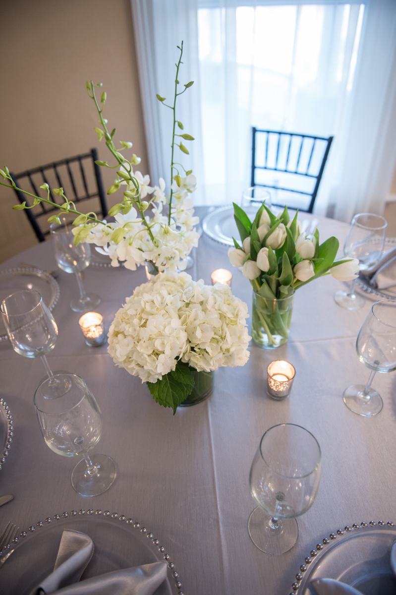Silver and Spring White with silver filigree votive make a simple table setting look elegant.