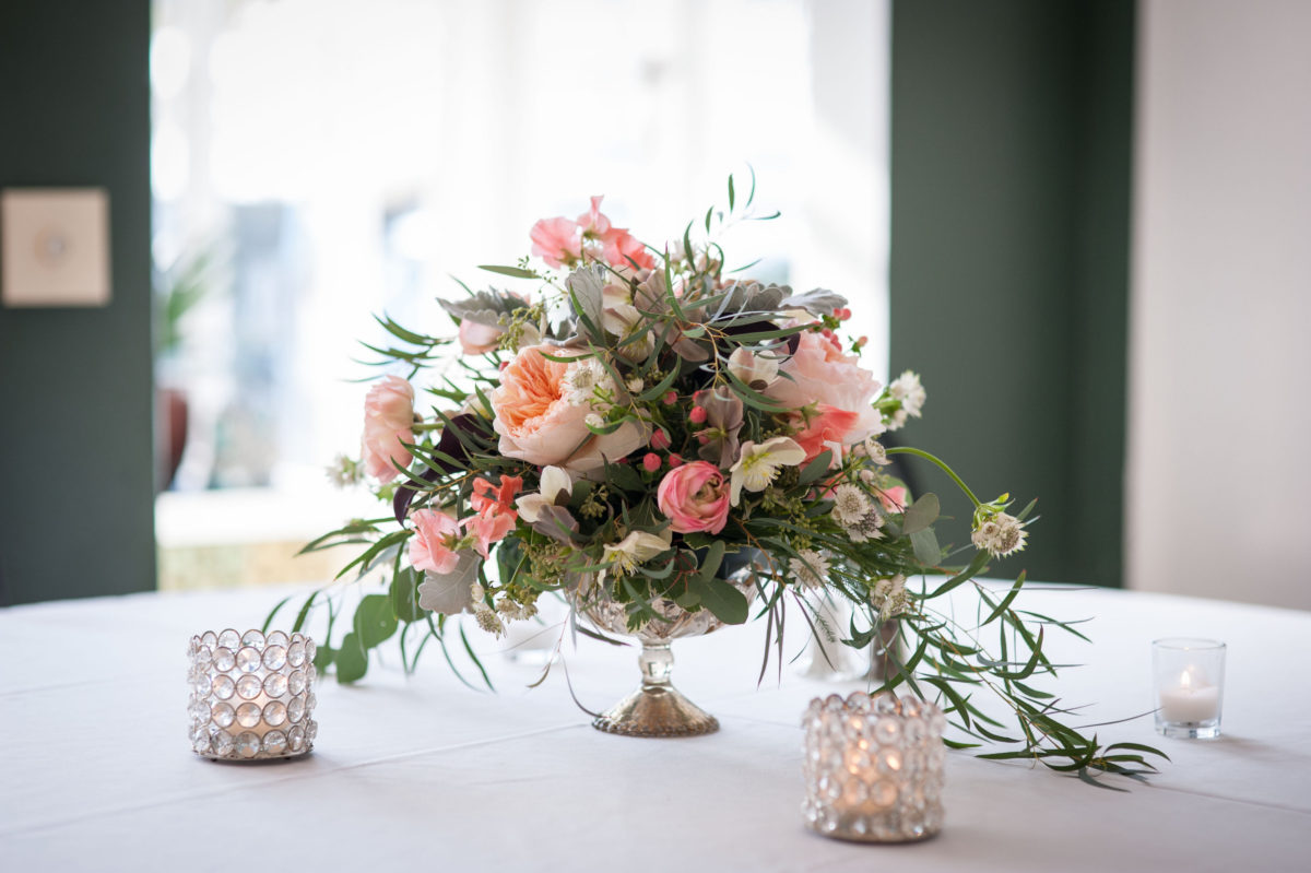 soft pink roses with peach peonies in a crystal bowl