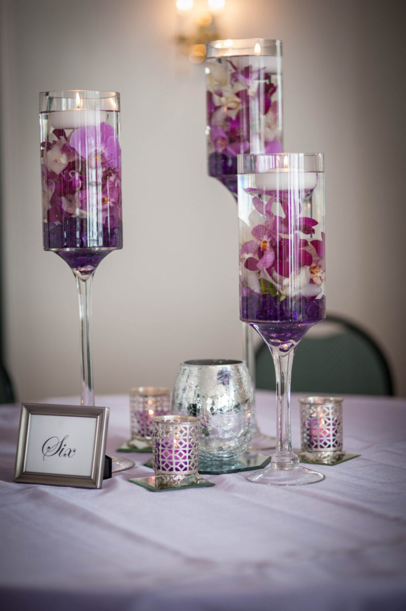 high floating candle holders with purple flowers