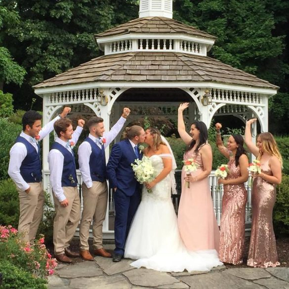 bride and groom with wedding party in front of the gazebo