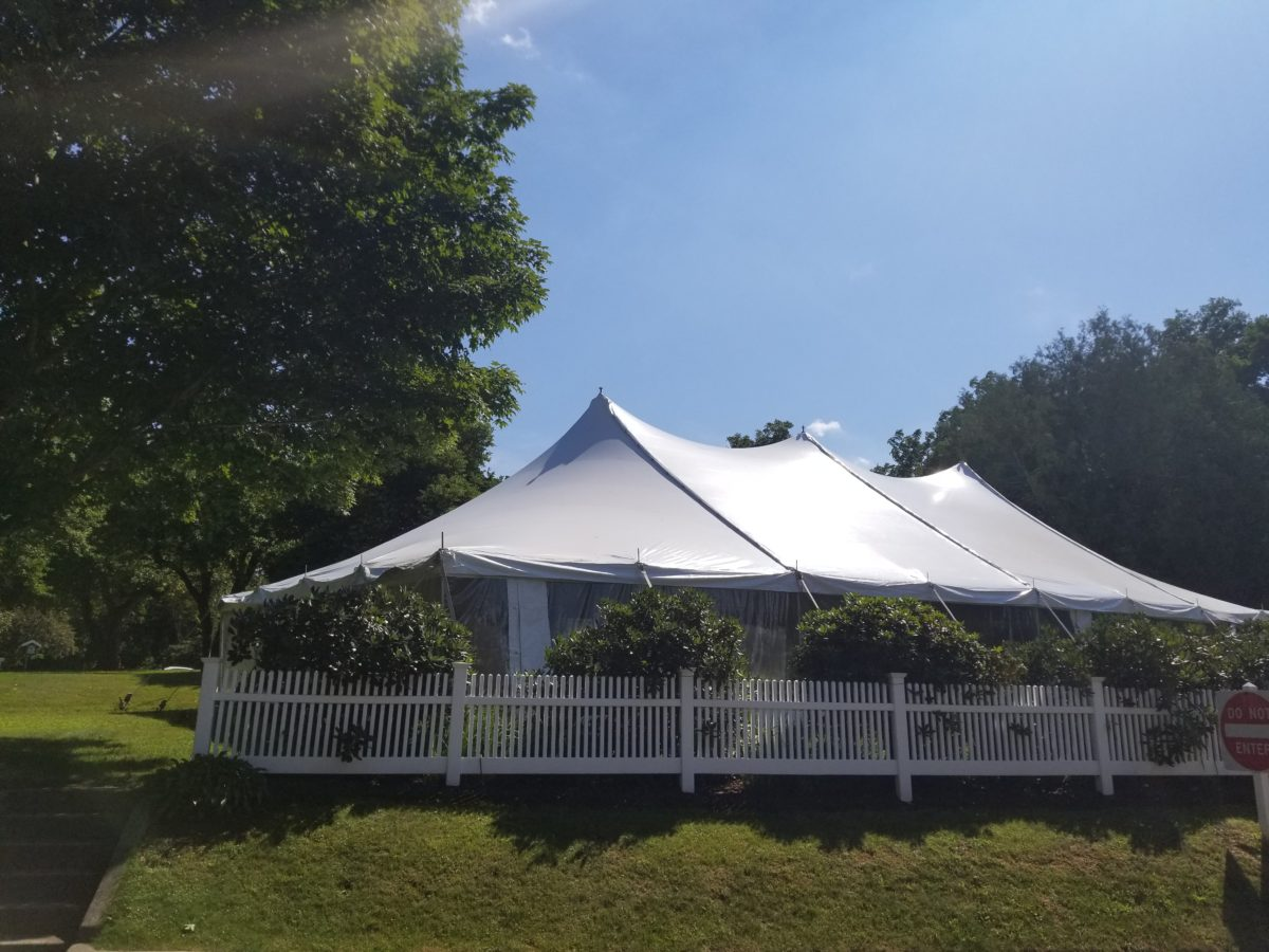 tent with side walls set up on lawn