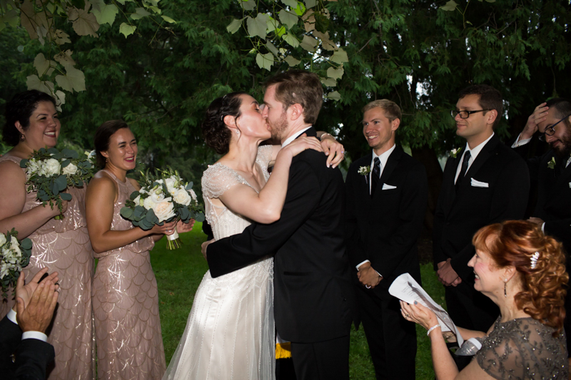 couple-kissing-after-art-deco-ceremony-under-the-grape-arbor