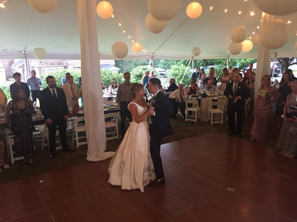 couple dancing under tent