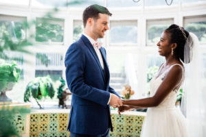 a-july-tent-wedding-couple-on-veranda