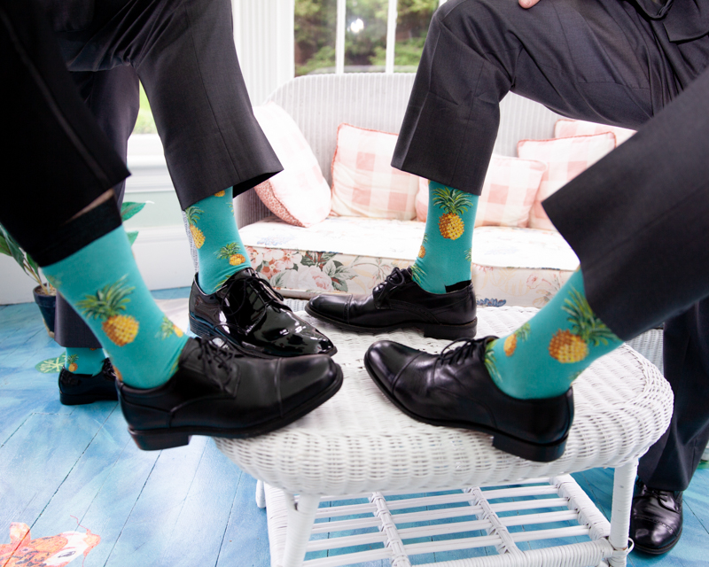 cuban-flair-wedding-four-legs-together-showing-off-their-pinapple-themed-socks