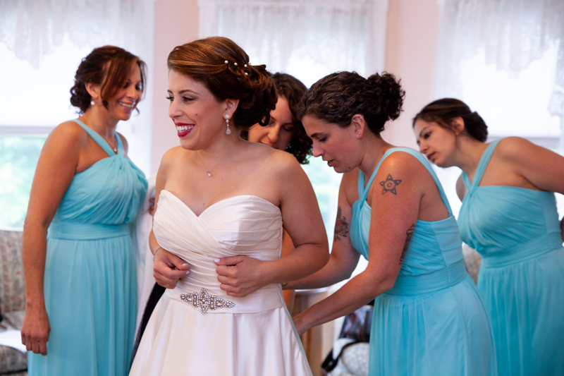 cuban-flair-wedding-Four-bridesmaids-in-aqua-helping-Rachel-into-her-gown