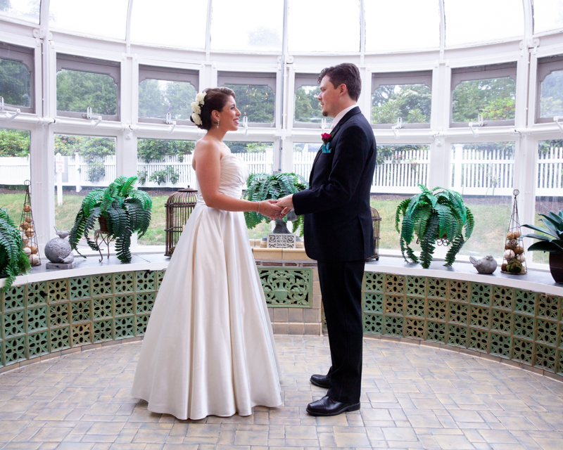 cuban-flair-wedding-rachel-robert-holdiing-hands-in-glass-conservatory