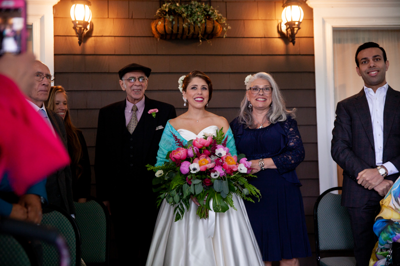 cuban-flair-wedding-bride-walking-with-her-mom-and-dad-down-the-aisle